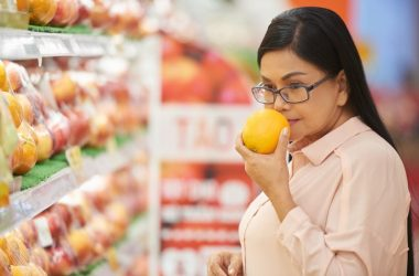 Mature woman smells orange scent to easy anxiety and stress
