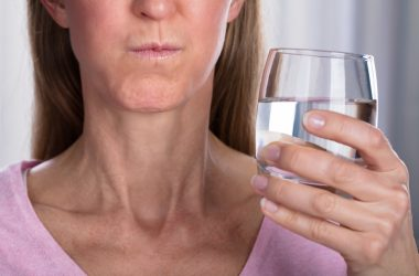Woman gargles with salt water to potentially reduce COVID-19 symptoms