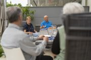 Seniors have a socially distanced gathering outdoors