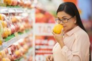 Woman smells orange to check sense of smell for dementia red flags